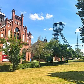 Front of a building in Zollern Colliery with a winding tower in the back.