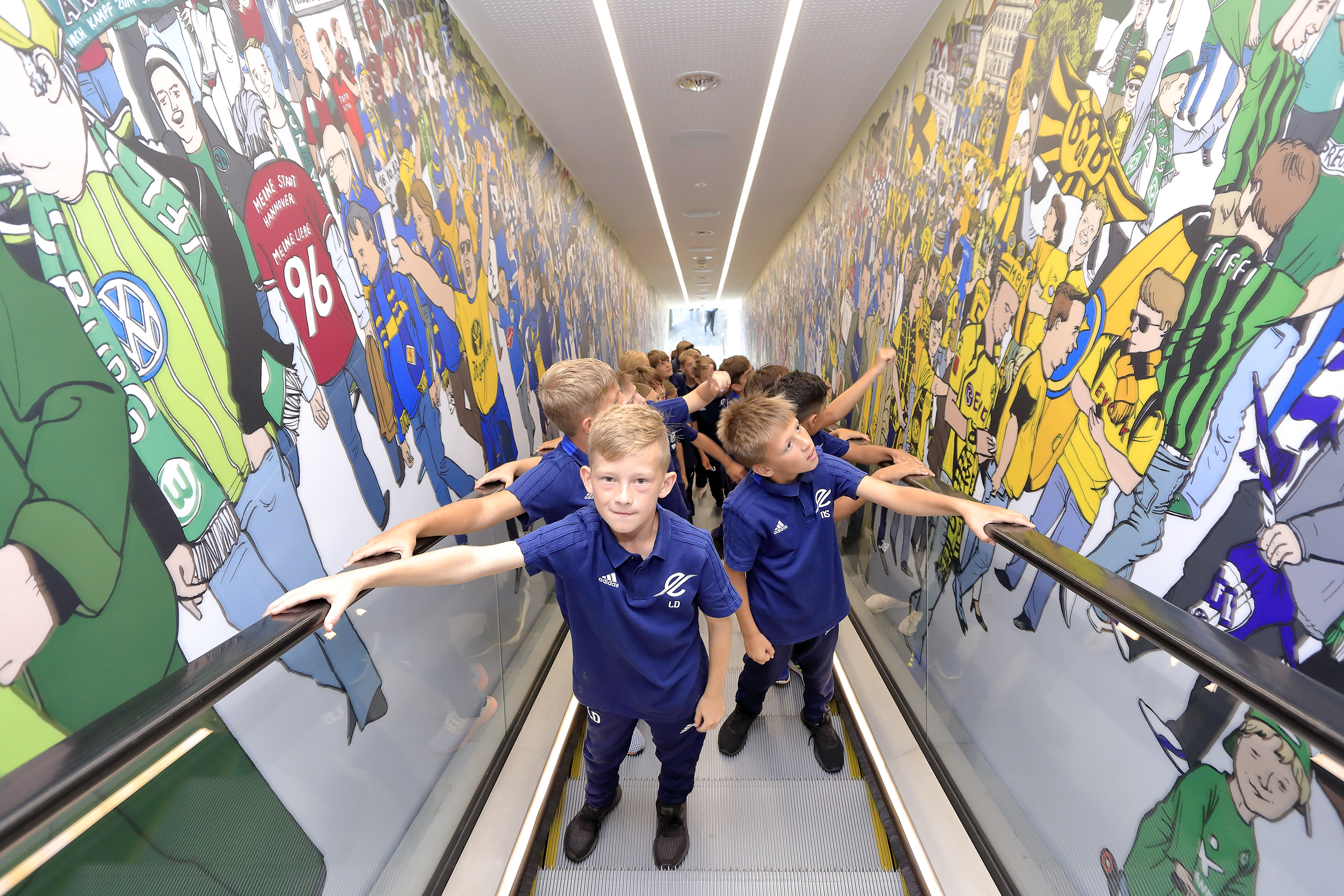 Children taking a look at a miniature stadium in the German Football Museum.